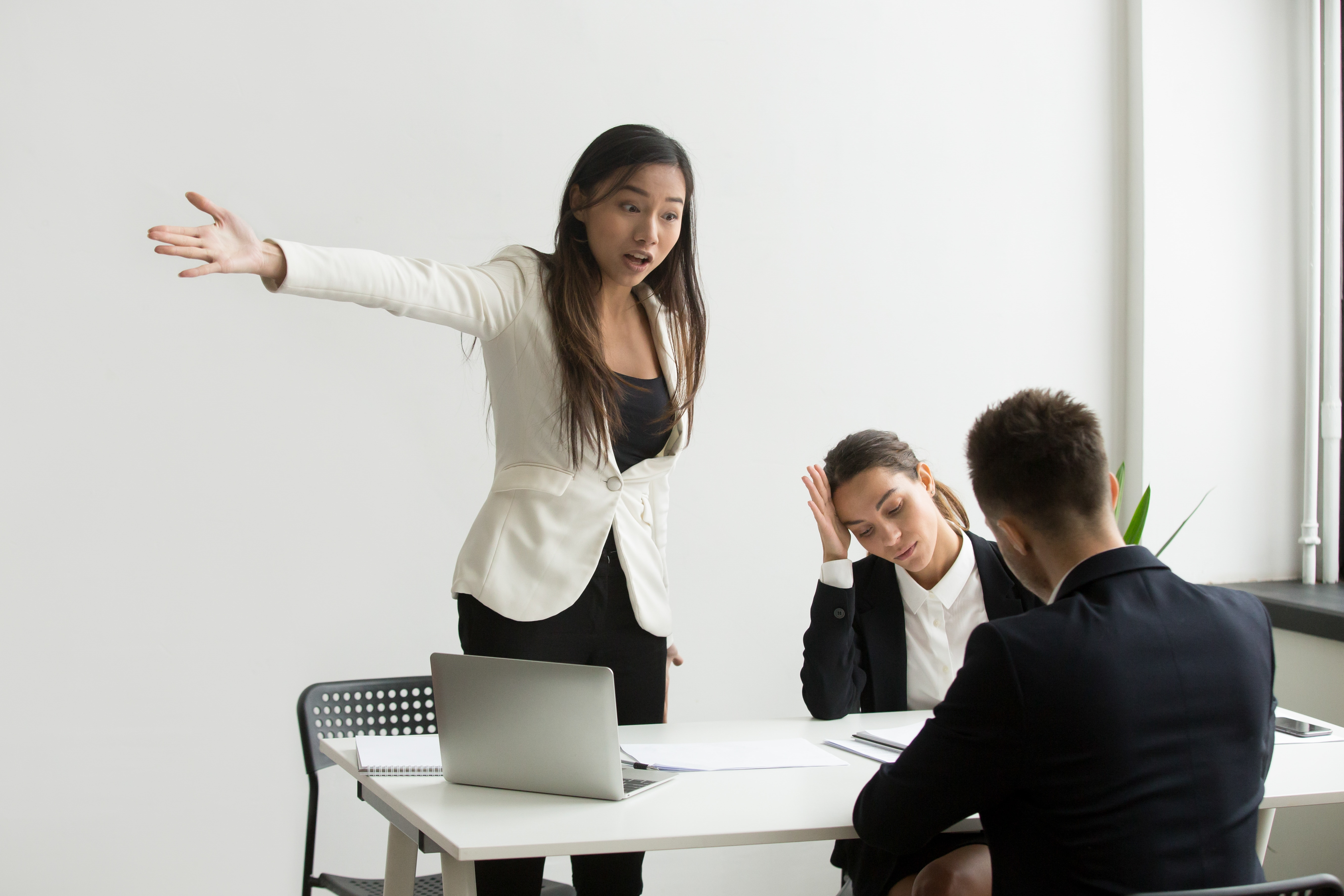 Mad HR representative pointing at door asking candidate to leave